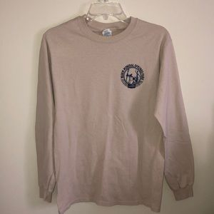 Cream colored long sleeve shirt